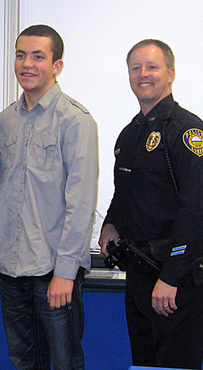 Officers Patton (above) and Houselog received an award from ADT for interupting a home invasion in progress.