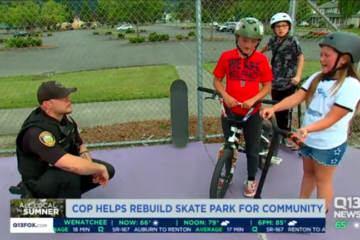 Screenshot of Q13 TV coverage of a Sumner police officer talking to kids using the skatepark