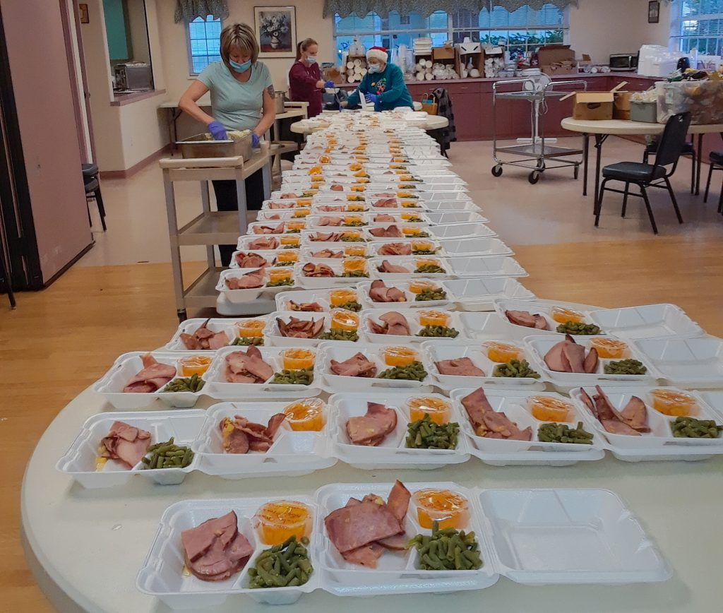Tables full of meals in to go containers