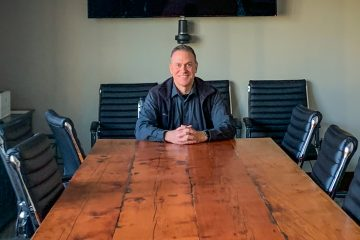 Deputy Chief Andy McCurdy sitting at a conference table